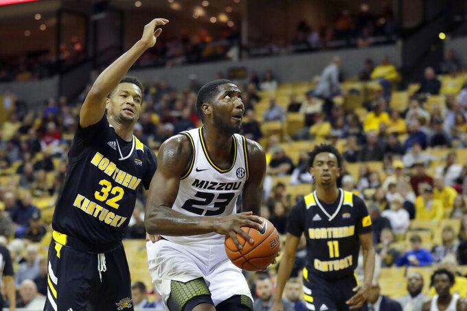 Missouri's Jeremiah Tilmon (23) heads to the basket as Northern Kentucky's Dantez Walton (32) and Jalen Tate (11) defend during the second half of an NCAA college basketball game Friday, Nov. 8, 2019, in Columbia, Mo. (AP Photo/Jeff Roberson)