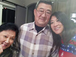 "This December 2016 photo provided by the family shows, from left, Lu Wang, Ming Wang and Anne Peterson. Ming Wang, 71, was sickened in March 2020 on a cruise from Australia with his wife, a break after decades of running the family's Chinese restaurant in Papillion, Neb. In the 74 days he was hospitalized, doctors desperately tried various experimental approaches, including enrolling him in a study of an antiviral drug that ultimately showed promise. Ming died on June 8. ""It was just touch and go. Everything they wanted to try we said yes, do it,"" said his daughter, Anne Peterson. ""We would give anything to have him back, but if what we and he went through would help future patients, that's what we want."" (Anne Peterson via AP)"