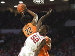 Oklahoma forward Kur Kuath (52) tries to get the ball away from Oklahoma St forward Kalib Boone (22) during the second half of an NCAA college basketball game in Norman, Okla., Saturday, Feb. 1, 2020. (AP Photo/Kyle Phillips)