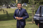 French President Emmanuel Macron arrives to meet French National Women's Soccer team during a visit at France's training camp in Clairefontaine, south of Paris, France, Tuesday, June 4 2019. The French women soccer team is preparing for the FIFA Women's World Cup that will start in France next Friday. (Christophe Petit Tesson, Pool via AP)