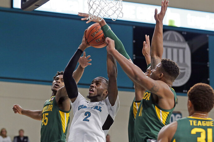 Coastal Carolina guard Garrick Green (2) drives to the basket while Baylor guards Davion Mitchell (45) and Mark Vital (11) defend during the first half of an NCAA college basketball game at the Myrtle Beach Invitational in Conway, S.C., Friday, Nov. 22, 2019. (AP Photo/Gerry Broome)