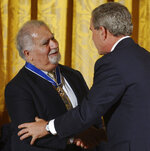 FILE - In this June 23, 2004, file photo, President Bush presents Vartan Gregorian with the Presidential Medal of Freedom, the nation's highest civil award, during a ceremony in the East Room of the White House in Washington. Gregorian, the noted scholar and philanthropic leader who has led the Carnegie Corporation of New York since 1997, died Thursday, April 15, 2021, after being hospitalized for stomach pain. He was 87. (AP Photo/Susan Walsh, File)
