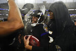 Baltimore Ravens kicker Justin Tucker (9) is surrounded by teammates after kicking the winning field goal against the San Francisco 49ers at the end of an NFL football game, Sunday, Dec. 1, 2019, in Baltimore, Md. Ravens won 20-17. (AP Photo/Nick Wass)