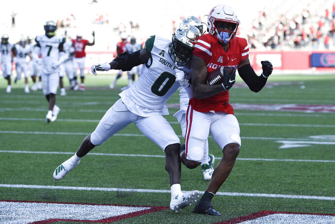 Houston wide receiver Keith Corbin, right, scores a touchdown past South Florida defensive back Daquan Evans during the first half of an NCAA college football game, Saturday, Nov. 14, 2020, in Houston. (AP Photo/Eric Christian Smith)