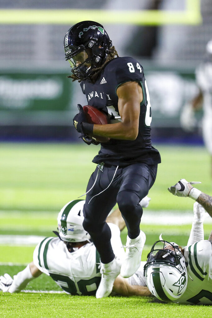 Hawaii wide receiver Nick Mardner (84) hauls in a catch ahead of two Portland State defenders during the second half of an NCAA college football game, Saturday, Sept. 4, 2021, in Honolulu. (AP Photo/Darryl Oumi)