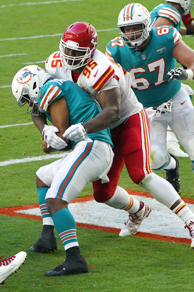 Kansas City Chiefs defensive tackle Chris Jones (95) sacks Miami Dolphins quarterback Tua Tagovailoa (1) in the endzone for a safety, during the second half of an NFL football game, Sunday, Dec. 13, 2020, in Miami Gardens, Fla. (AP Photo/Wilfredo Lee)