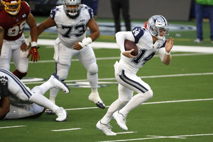 Dallas Cowboys quarterback Andy Dalton (14) scrambles out of the pocket and carries the ball for a gain in the first half of an NFL football game against the Washington Football Team in Arlington, Texas, Thursday, Nov. 26, 2020. (AP Photo/Roger Steinman)