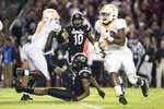 Tennessee running back Ty Chandler, right, runs with the ball during the first half of an NCAA college football game against South Carolina, Saturday, Oct. 27, 2018, in Columbia, S.C. (AP Photo/Sean Rayford)