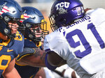 West Virginia offensive lineman James Gmiter (74) blocks TCU  defensive tackle Patrick Jenkins (91) during the second half of an NCAA college football game on Saturday, Nov. 14, 2020, in Morgantown, W.Va. (William Wotring/The Dominion-Post via AP)