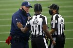 Dallas Cowboys head coach Mike McCarthy talks with referee Jeff Triplette (42) and referee Walt Coleman (65) in the first half of an NFL football game against the Atlanta Falcons in Arlington, Texas, Sunday, Sept. 20, 2020. (AP Photo/Ron Jenkins)