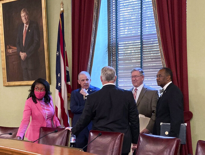 FILE - In this Friday, Aug. 6, 2021 file photo, from left to right, Ohio House Democratic Leader Emilia Sykes, Senate President Matt Huffman, House Speaker Bob Cupp, both Republicans, and Democratic state Sen. Vernon Sykes speak to Auditor Keith Faber at the Ohio Statehouse in Columbus, Ohio, ahead of the first meeting of the Ohio Redistricting Commission on which they all sit. The panel overseeing the redrawing of Ohio's legislative districts for the coming decade is traveling the state this week to gather input on what the maps should look like. The first of nine public hearings hosted by the new Ohio Redistricting Commission kicks off Monday morning, Aug. 23 in Cleveland.  (AP Photo/Julie Carr Smyth, File)