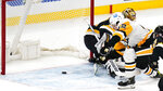 Pittsburgh Penguins right wing Kasperi Kapanen (42) scores on Boston Bruins goaltender Tuukka Rask during the third period of an NHL hockey game, Tuesday, Jan. 26, 2021, in Boston. (AP Photo/Charles Krupa)