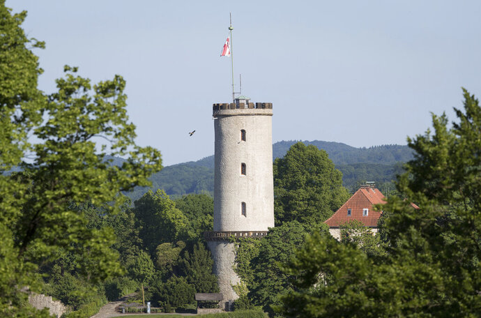FILE - In this May 27, 2017 file photo, a castle is pictured in Bielefeld, Germany. The Germany city that's been the subject of a long-running online conspiracy theory claiming it doesn't really exist is offering big bucks to whoever proves that's true. City officials in Bielefeld said Wednesday they'll give 1 million euros ($1.1 million) to the person who delivers solid proof of its non-existence. (Friso Gentsch/dpa via AP)