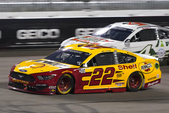 Joey Logano (22) leads Kevin Harvick (4) at the start of Stage 2 during a NASCAR Cup Series auto race Saturday, Sept. 12, 2020, in Richmond, Va. (AP Photo/Steve Helber)