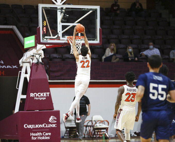 Virginia Tech's Keve Aluma (22) scores in the second half of an NCAA college basketball game against Longwood in Blacksburg, Va., Monday, Dec. 21, 2020. (Matt Gentry/The Roanoke Times via AP, Pool)