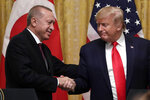FILE - In this Nov. 13, 2019, file photo, President Donald Trump shakes hands with Turkish President Recep Tayyip Erdogan after a news conference in the East Room of the White House, in Washington. President Joe Biden has often touted the personal relationships he's developed with world leaders over nearly 50 years in national politics as a factor that makes him uniquely equipped to revitalize the reputation of the United States following the presidency of Trump. He's mentioned to aides that he's developed a strong rapport with Erdogan over the years, according to a senior administration official who spoke on the condition of anonymity to discuss private conversations. (AP Photo/ Evan Vucci, File)