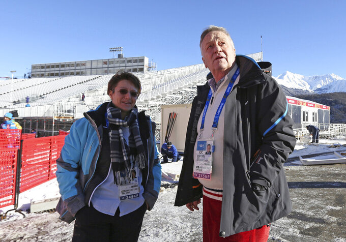 FILE - In this file photo dated Monday, Feb. 3, 2014, Sarah Lewis, Secretary General and Gian Franco Kasper, President of the FIS, the International Ski Federation, right, visit the finish area of the Aline ski course ahead of the 2014 Winter Olympics, in Krasnaya Polyana, Russia.  Lewis has declared herself a candidate on Tuesday April 6, 2021, to become the first woman president of the International Ski Federation.(AP Photo/Alessandro Trovati, FILE)