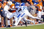 Tennessee tight end Dominick Wood-Anderson (4) is driven out of bounds after catching by Kentucky safety Mike Edwards (7) and safety Tyrell Ajian (23) in the first half of an NCAA college football game Saturday, Nov. 10, 2018, in Knoxville, Tenn. (AP Photo/Wade Payne)