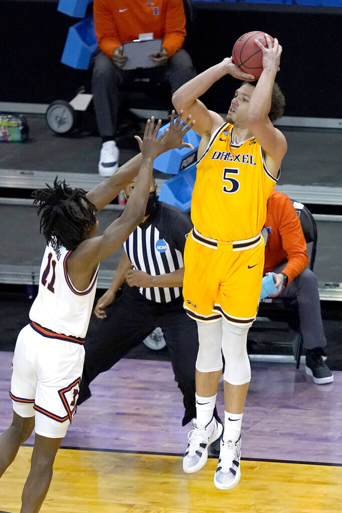 Drexel's Zach Walton (5) shoots over Illinois guard Ayo Dosunmu, during the first half of a first round NCAA college basketball tournament game Friday, March 19, 2021, at the Indiana Farmers Coliseum in Indianapolis .(AP Photo/Charles Rex Arbogast)