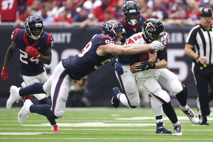 Atlanta Falcons quarterback Matt Ryan (2) is hit by Houston Texans defensive end J.J. Watt (99) during the first half of an NFL football game Sunday, Oct. 6, 2019, in Houston. (AP Photo/Eric Christian Smith)