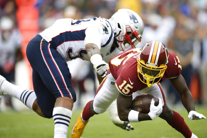 Washington Redskins wide receiver Steven Sims (15) is hits by New England Patriots outside linebacker Dont'a Hightower (54) during the first half of an NFL football game, Sunday, Oct. 6, 2019, in Washington. (AP Photo/Nick Wass)