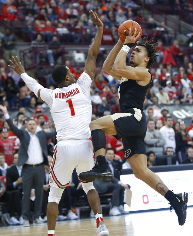 Purdue's Carsen Edwards, right, shoots over Ohio State's Luther Muhammad during the first half of an NCAA college basketball game Wednesday, Jan. 23, 2019, in Columbus, Ohio. (AP Photo/Jay LaPrete)