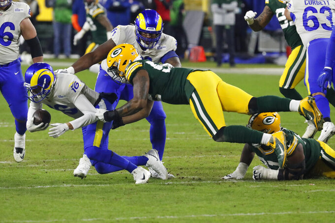 Green Bay Packers' Rashan Gary (52) sacks Los Angeles Rams quarterback Jared Goff (16) during the second half of an NFL divisional playoff football game Saturday, Jan. 16, 2021, in Green Bay, Wis. (AP Photo/Mike Roemer)
