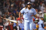 Toronto Blue Jays' Vladimir Guerrero Jr. tosses his bat after hitting a three-run home run in the fifth inning of the team's baseball game against the Boston Red Sox at Fenway Park, Thursday, July 29, 2021, in Boston. (AP Photo/Elise Amendola)