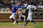 New York Mets' Brandon Nimmo (9) scores on a wild pitch by Los Angeles Dodgers pitcher Edwin Uceta (92) during the seventh inning of a baseball game on Sunday, Aug. 15, 2021, in New York. (AP Photo/Adam Hunger)