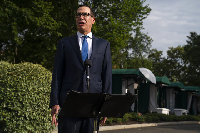 Treasury Secretary Steven Mnuchin speaks with reporters about the coronavirus relief package negotiations, at the White House, Thursday, July 23, 2020, in Washington. (AP Photo/Evan Vucci)