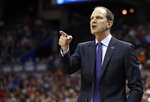Washington head coach Mike Hopkins yells instructions to players in the first half against North Carolina during a second-round men's college basketball game in the NCAA Tournament in Columbus, Ohio, Sunday, March 24, 2019. (AP Photo/Tony Dejak)