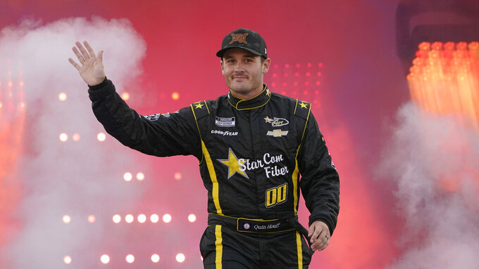 Quinn Houff waves to the crowd during driver introductions prior to the start of the NASCAR Cup series auto race in Richmond, Va., Saturday, Sept. 11, 2021. (AP Photo/Steve Helber)