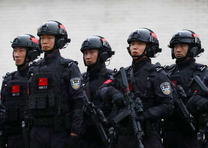 Chinese security forces performs during a joint anti-terrorist drill in the Zelezara Smederevo steel mill, in the city of Smederevo, 45 kilometers east of Belgrade, Serbia, Thursday, Nov. 28, 2019. Serbian and Chinese security forces are holding a joint anti-terrorist drills in the Balkan country in a sign of Beijing's increasing influence in the volatile region. (AP Photo/Darko Vojinovic)