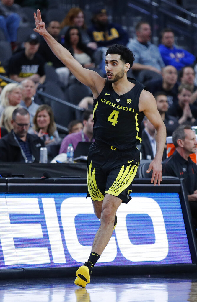 Oregon's Ehab Amin celebrates after making a 3-point shot against Utah during the first half of an NCAA college basketball game in the quarterfinals of the Pac-12 men's tournament Thursday, March 14, 2019, in Las Vegas. (AP Photo/John Locher)