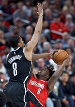 Portland Trail Blazers forward Nassir Little, right, shoots in front of Brooklyn Nets guard Spencer Dinwiddie during the first half of an NBA basketball game in Portland, Ore., Friday, Nov. 8, 2019. (AP Photo/Craig Mitchelldyer)