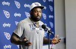 FILE - In this April 15, 2019, file photo, Tennessee Titans tight end Delanie Walker answers questions during a news conference in Nashville, Tenn. The Tennessee Titans have waived three-time Pro Bowl tight end Delanie Walker after injuries ended each of his last two season. The Titans announced the move Friday, March 13, 2020. (AP Photo/Mark Humphrey, File)