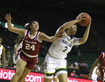 Baylor guard Trinity Oliver, right, pulls in a loose ball over Oklahoma guard Skylar Vann, left, in the first half of an NCAA college basketball game, Saturday, Jan. 23, 2021, in Waco, Texas. (Rod Aydelotte/Waco Tribune-Herald via AP)