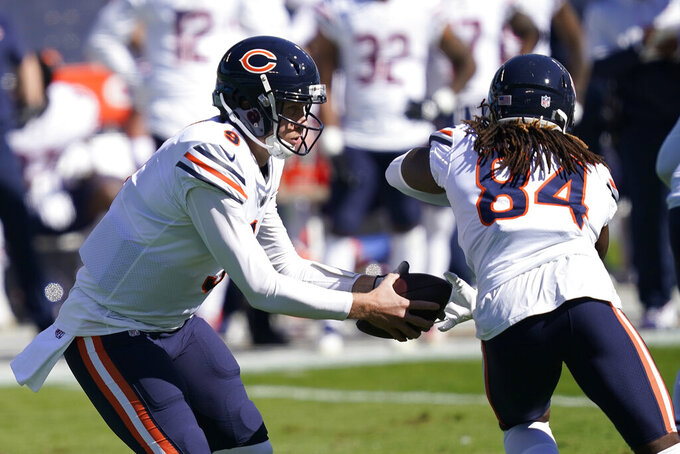Chicago Bears quarterback Nick Foles (9) fakes a handoff to wide receiver Cordarrelle Patterson (84) during the first half of an NFL football game against the Carolina Panthers in Charlotte, N.C., Sunday, Oct. 18, 2020. (AP Photo/Brian Blanco)