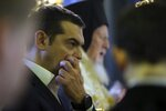 Greece's Prime Minister Alexis Tsipras attends a church service during his visit at the Theological School of Halki, in Heybeli Island, near Istanbul, Wednesday, Feb. 6, 2019. The president of Turkey and the prime minister of Greece agreed Tuesday on the need to keep