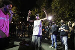 A performer, left, raps as a man dances during a Black Lives Matter protest at the Mark O. Hatfield United States Courthouse Thursday, July 30, 2020, in Portland, Ore. After days of clashes with federal police, the crowd outside of the federal courthouse remained peaceful Thursday night. (AP Photo/Marcio Jose Sanchez)