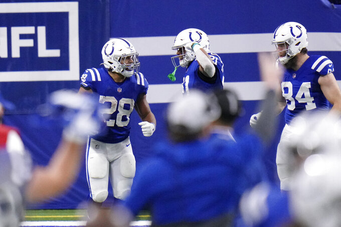 Indianapolis Colts' Jonathan Taylor (28) celebrates after running for a touchdown during the second half of an NFL football game against the Jacksonville Jaguars, Sunday, Jan. 3, 2021, in Indianapolis. (AP Photo/AJ Mast)