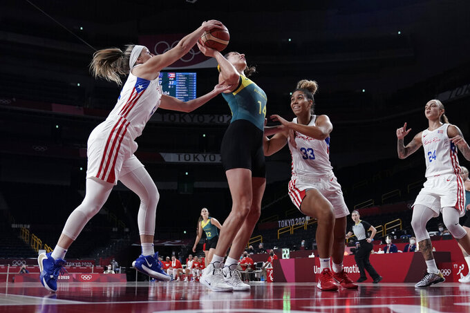 Australia's Marianna Tolo (14) is blocked by Puerto Rico's Ali Gibson, left, during a women's basketball game at the 2020 Summer Olympics, Monday, Aug. 2, 2021, in Saitama, Japan. (AP Photo/Eric Gay)