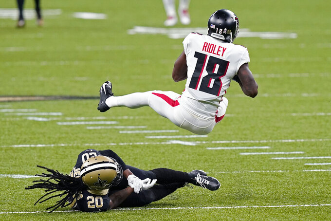 Atlanta Falcons wide receiver Calvin Ridley (18) pulls in a pass over New Orleans Saints cornerback Janoris Jenkins (20) in the first half of an NFL football game in New Orleans, Sunday, Nov. 22, 2020. (AP Photo/Butch Dill)