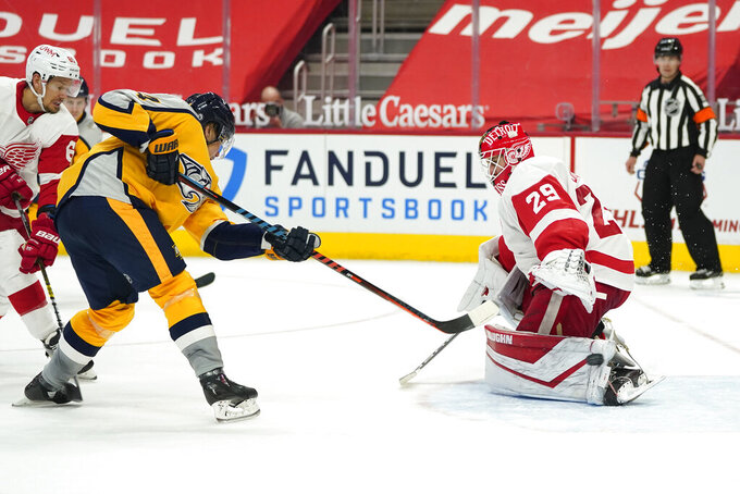 Nashville Predators center Mikael Granlund (64) scores on Detroit Red Wings goaltender Thomas Greiss (29) in the third period of an NHL hockey game Tuesday, April 6, 2021, in Detroit. (AP Photo/Paul Sancya)