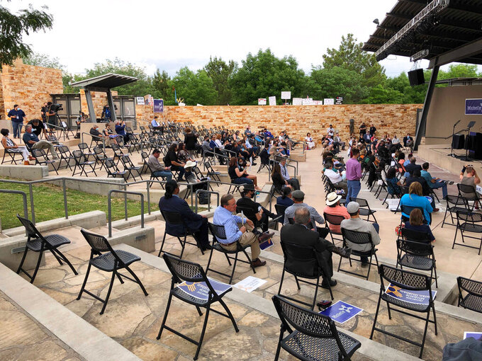 Supporters gather ahead of New Mexico Gov. Michelle Lujan Grisham's first major campaign rally as the Democrat seeks reelection in Albuquerque, on Thursday, June 3, 2021. (AP Photo/Susan Montoya Bryan)