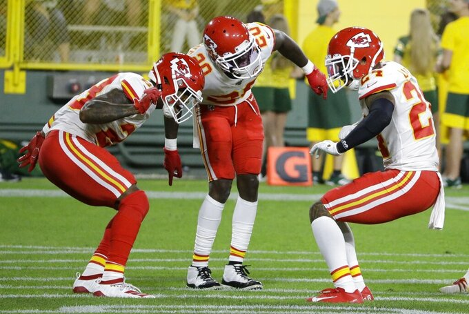 Kansas City Chiefs' Jordan Lucas celebrates his interception with Armani Watts and Morris Claiborne during the first half of a preseason NFL football game against the Green Bay Packers Thursday, Aug. 29, 2019, in Green Bay, Wis. (AP Photo/Mike Roemer)