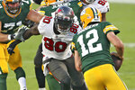 Tampa Bay Buccaneers outside linebacker Jason Pierre-Paul (90) chases Green Bay Packers quarterback Aaron Rodgers (12) during the second half of an NFL football game Sunday, Oct. 18, 2020, in Tampa, Fla. (AP Photo/Mark LoMoglio)