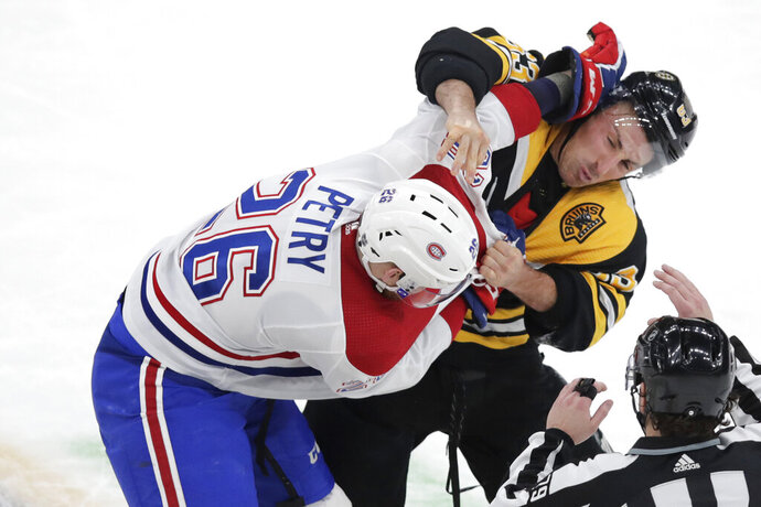 Boston Bruins left wing Brad Marchand, right, and Montreal Canadiens defenseman Jeff Petry (26) fight during the first period of an NHL hockey game in Boston, Wednesday, Feb. 12, 2020. (AP Photo/Charles Krupa)