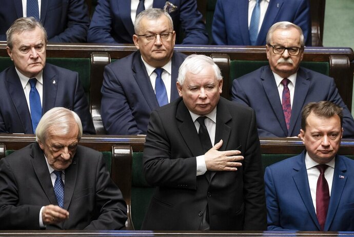 The leader of Poland's ruling right-wing Law and Justice party, Jaroslaw Kaczynski, center, swears in as a member of the parliament during a gala inauguration of a new four-year term of the national parliament in Warsaw, Poland, Tuesday, Nov. 12, 2019.(AP Photo)