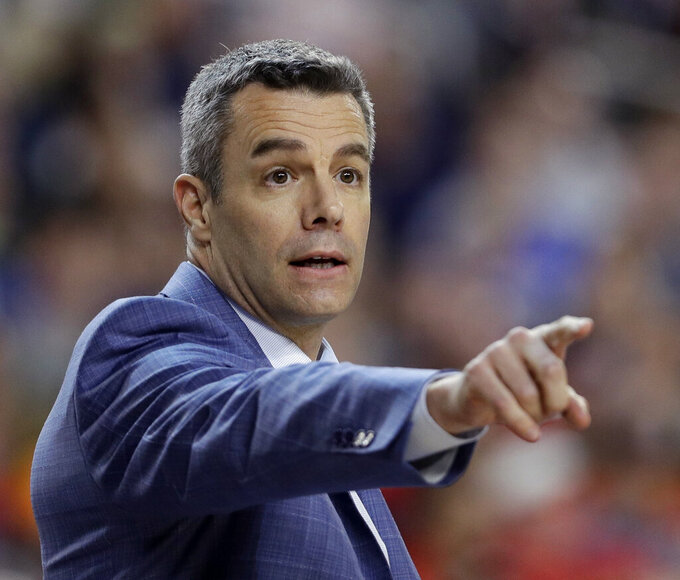 FILE - In this  Monday, April 8, 2019 file photo, Virginia head coach Tony Bennett directs his team during the first half against Texas Tech in the championship game of the Final Four NCAA college basketball tournament in Minneapolis. Tony Bennett's first offseason as a national champion coach has come with benefits on the recruiting trail. His first season at Virginia after winning the title, however, will bring challenges. (AP Photo/David J. Phillip, File)